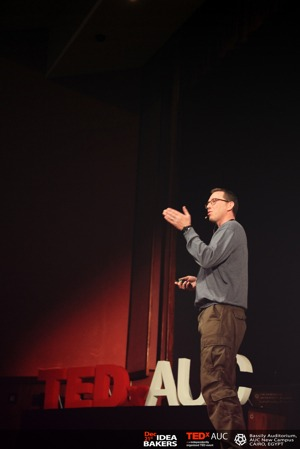 Con speaking at TEDxAUC in Feb. 2013.
