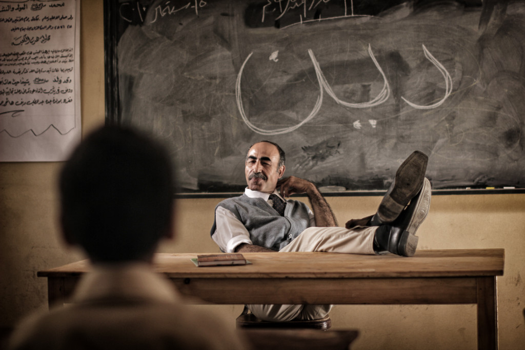 """A shot from a religion class at the school. The word """"religion"""" is written on the blackboard. Courtesy of Aly El Banna."""