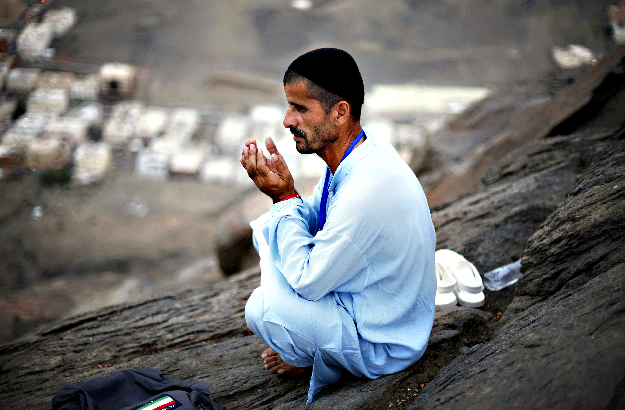 A Muslim pilgrim prays at Mount Al-Noor ahead of the annual haj pilgrimage in Mecca...A Muslim pilgrim prays at Mount Al-Noor ahead of the annual haj pilgrimage in Mecca October 10, 2013. Mount Al-Noor houses Ghar-E-Hira or Hira cave, where Prophet Mohammad is said to have spent a great deal of time in the cave meditating and it is believed that he had received his first revelation inside this cave. REUTERS/Ibraheem Abu Mustafa (SAUDI ARABIA - Tags: RELIGION)