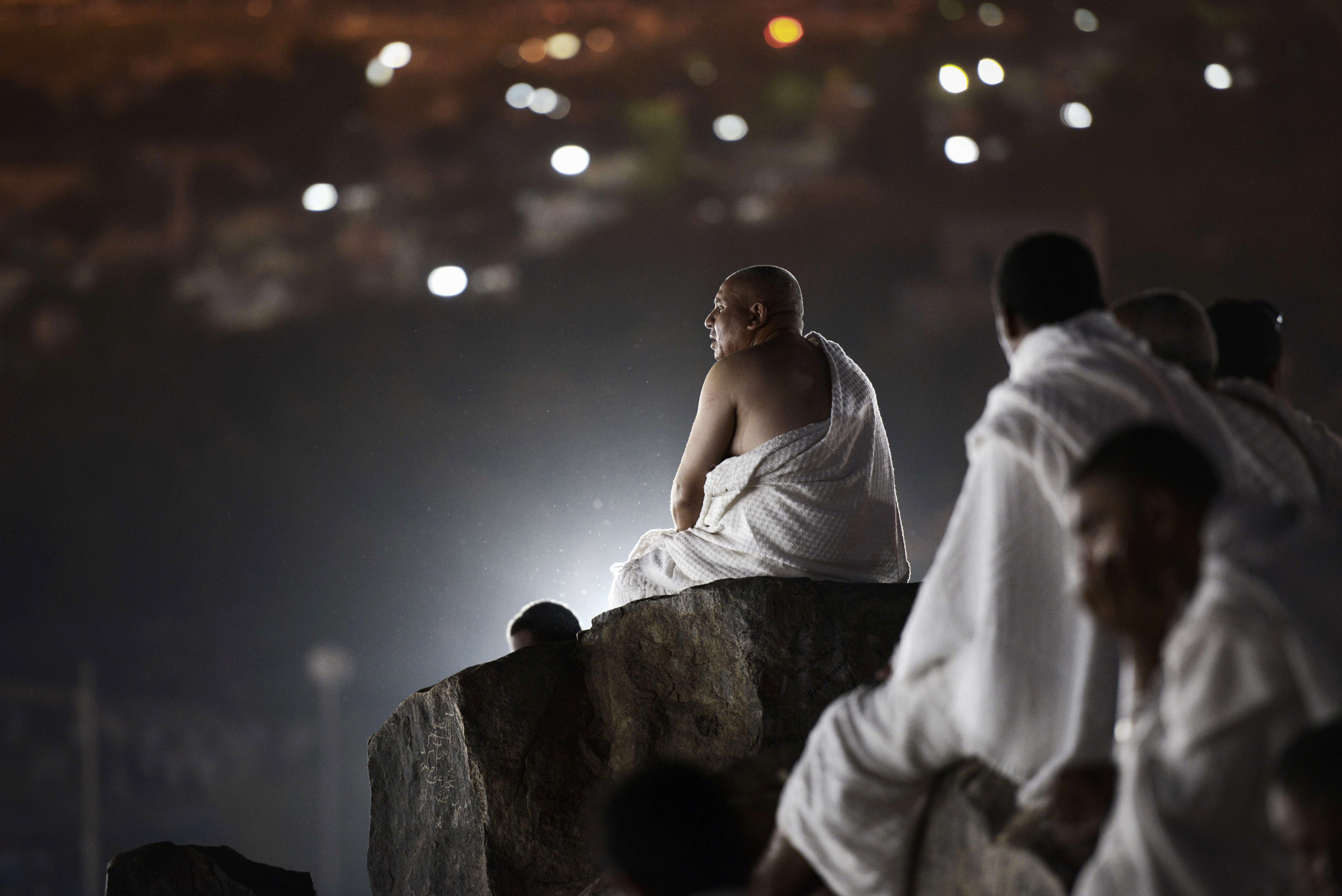 Muslim pilgrims gather on Mount Arafat near Mecca as they perform one of the Hajj rituals late on October 3, 2014. The pilgrims perform a series of rituals during the annual Hajj. They circumambulate the kaaba seven times, runs back and forth between the hills of Al-Safa and Al-Marwah, drink from the Zamzam Well, goes to the plains of Mount Arafat to stand in vigil, and throws stones in a ritual Stoning of Devil. The pilgrims then shave their heads, perform a ritual of animal sacrifice, and celebrate Eid al-Adha holiday. AFP PHOTO/MOHAMMED AL-SHAIKHMOHAMMED AL-SHAIKH/AFP/Getty Images