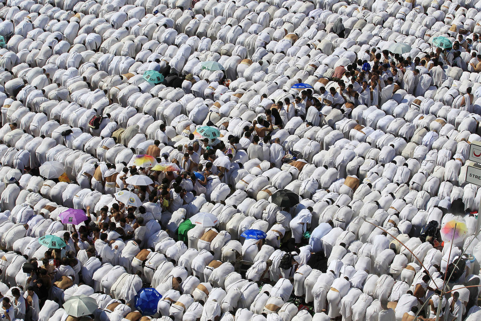 Muslim pilgrim pray outside Namira mosque in Arafat near Mecca, Saudi Arabia, Saturday, Nov. 5, 2011. The annual Islamic pilgrimage draws 2.5 million visitors each year, making it the largest yearly gathering of people in the world. (AP Photo/Hassan Ammar)