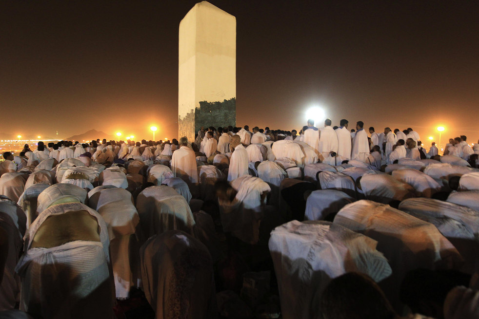 Muslim pilgrims pray on a rocky hill called the Mountain of Mercy, on the Plain of Arafat near Mecca, Saudi Arabia, Saturday, Nov. 5, 2011. The annual Islamic pilgrimage draws 2.5 million visitors each year, making it the largest yearly gathering of people in the world. (AP Photo/Hassan Ammar)
