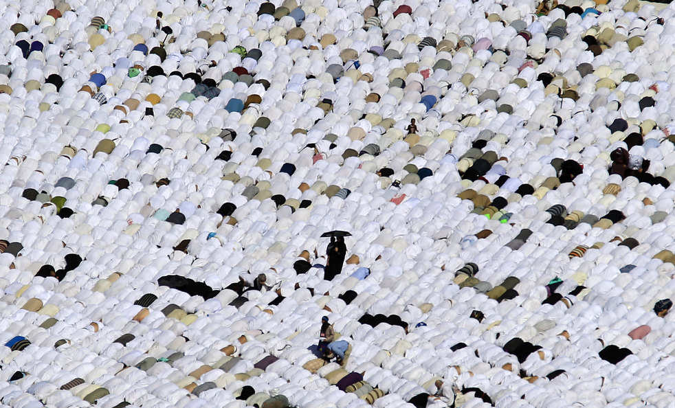 Tens of thousands of Muslim pilgrims pray inside the Grand Mosque, in Mecca, Saudi Arabia, Friday, Nov. 4, 2011. The annual Islamic pilgrimage draws three million visitors each year, making it the largest yearly gathering of people in the world. The Hajj will begin on November 5. (AP Photo/Hassan Ammar)