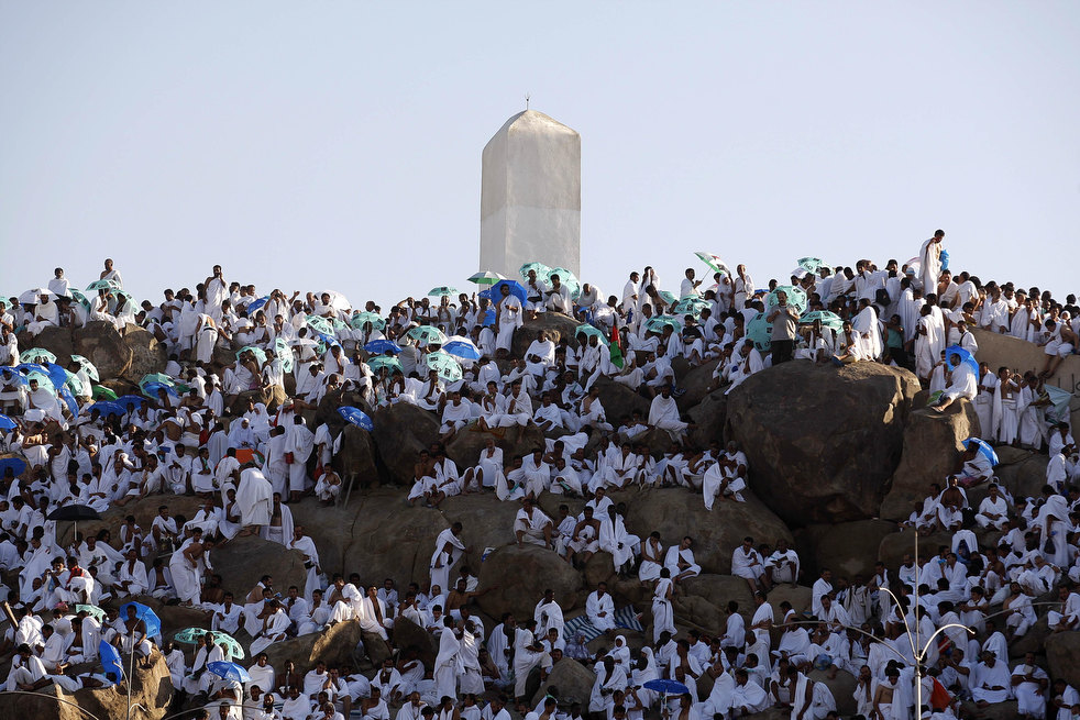 Muslim pilgrims pray on a rocky hill called the Mountain of Mercy, on the Plain of Arafat near Mecca, Saudi Arabia, Friday, Nov. 4, 2011. The annual Islamic pilgrimage draws 2.5 million visitors each year, making it the largest yearly gathering of people in the world. (AP Photo/Hassan Ammar)
