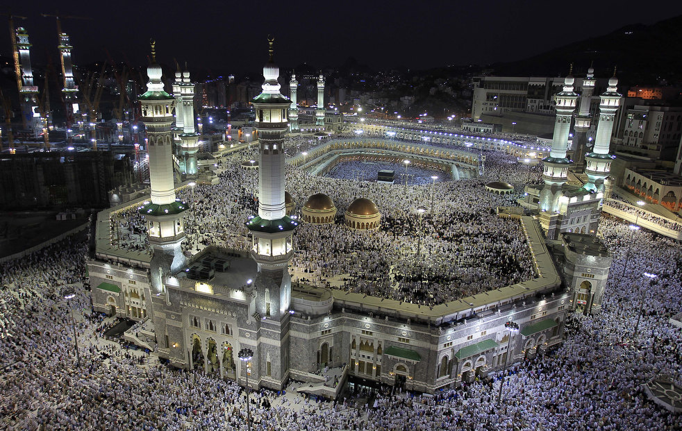Tens of thousands of Muslim pilgrims move around the Kaaba, seen at center, inside the Grand Mosque, in Mecca, Saudi Arabia, Thursday, Nov. 3, 2011. The annual Islamic pilgrimage draws three million visitors each year, making it the largest yearly gathering of people in the world. The Hajj will begin on November 5. (AP Photo/Hassan Ammar)