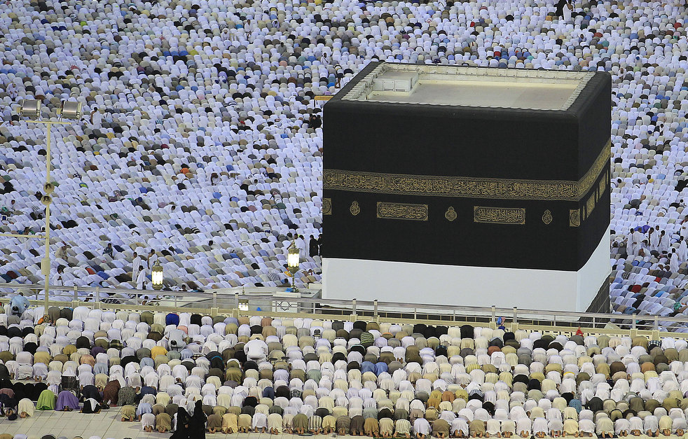 Tens of thousands of Muslim pilgrims pray outside and inside the Grand Mosque,, in Mecca, Saudi Arabia, Thursday, Nov. 3, 2011. The annual Islamic pilgrimage draws three million visitors each year, making it the largest yearly gathering of people in the world. The Hajj will begin on November 5. (AP Photo/Hassan Ammar)